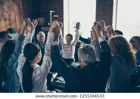 Collaboration join union unity cooperation concept. Close up view photo of excited first best lucky satisfied glad people raise fist up make chain stand in circle round #1255346533