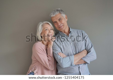 Lovely portrait of attractive senior couple on grey background                               #1255404175
