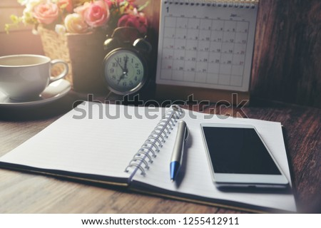 Diary, Calendar and agenda for Event Planner to plan timetable, appointment, organization, management on office table. Desktop Calender and coffee place on wooden desk. Calendar Background Concept #1255412911