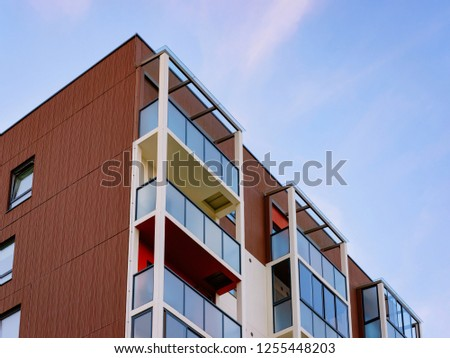 Apartment home residential building complex real estate concept. Place for copy space. With a blue sky #1255448203