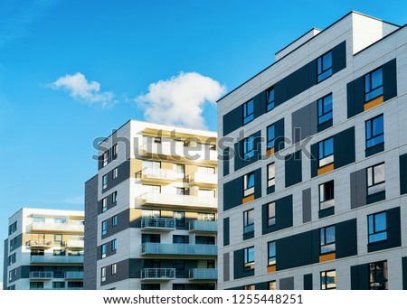 Apartment houses and homes residential buildings complex real estate concept. Place for copy space #1255448251