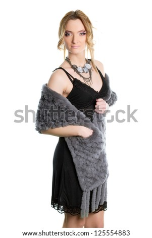 Portrait of nice young woman in a black cocktail dress. Isolated #125554883