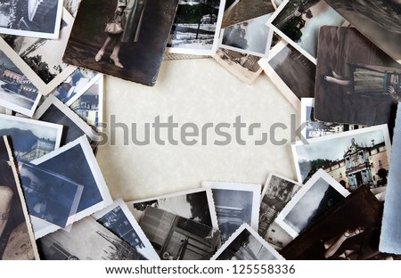 Stack of old photos with space for your logo or text.
