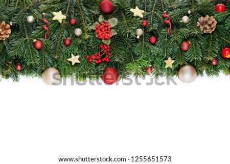 Christmas decorative background border with red bauble decorations, holly berries, spruce and pine cones #1255651573