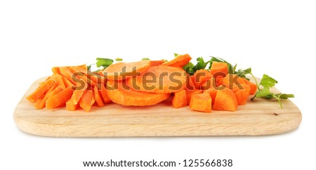 carrots on cutting board on table in kitchen #125566838