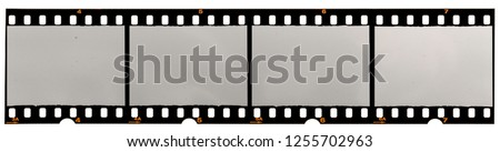 long filmstrip on white, picture placeholder with empty or blank frames #1255702963