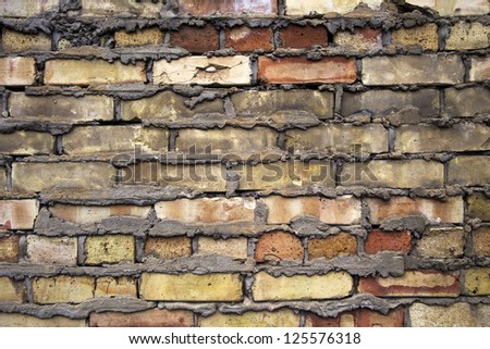 Detailed image of bricked wall and concrete. #125576318