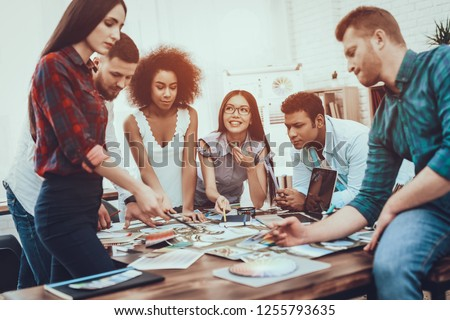 Young. Designers. Different Nationalities. Tam of Young People. Generate Idea. Color. Design. Project. Cooperation. Group. Spend Brainstorming. Work. Table. Teamwork. Large Bright Office. #1255793635