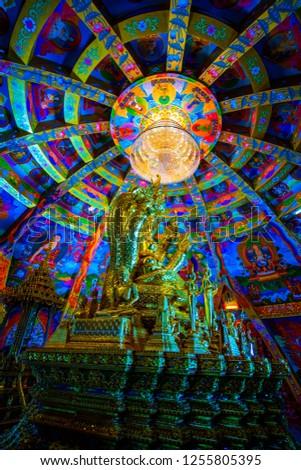 Buddha statue set in beautiful dome, Thailand. #1255805395