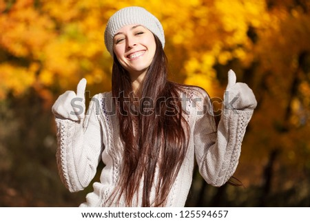 happy girl on a background of autumn trees #125594657