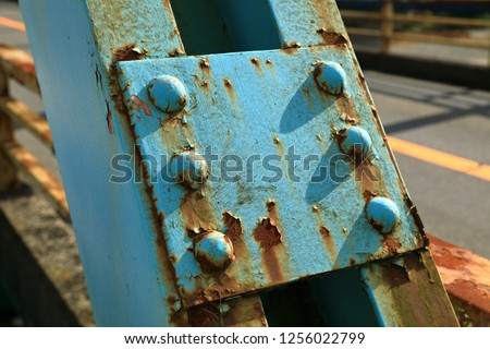 Rust of metals. Corrosion of metal. Rust and corrosion in the weld.Corrosive Rust on old iron, grunge rust texture, Rush on metal fench of old bridge.  #1256022799