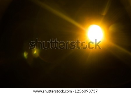 Abstract Natural Sun flare on the black #1256093737