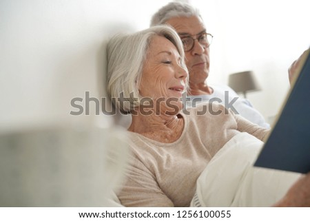 Senior couple relaxing and reading in bed                               #1256100055