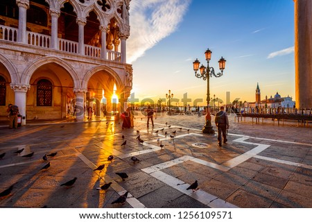Sunrise view of piazza San Marco, Doge's Palace (Palazzo Ducale) in Venice, Italy. Architecture and landmark of Venice. Sunrise cityscape of Venice. #1256109571