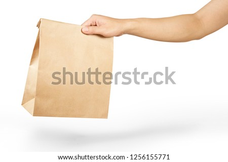Right hand holidng a brown paper bag isolated on white with clipping path. #1256155771