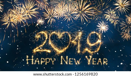 Greeting card Happy New Year 2019. Beautiful Wide Angle holiday web banner or billboard with Golden sparkling text Happy New Year 2019 written sparklers on festive blue background. #1256169820