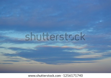 Textural clouds on at sunset background #1256171740