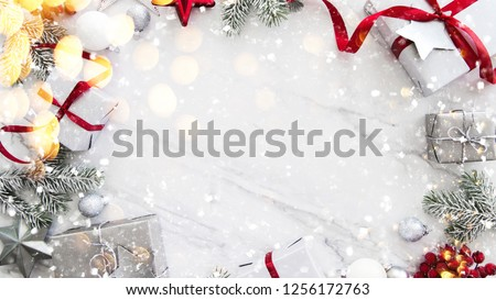 Christmas silver and red gifts and ornaments on white marble background top view. Merry Christmas greeting card, frame. Winter xmas holiday theme. Noel. Happy New Year. Flat lay #1256172763