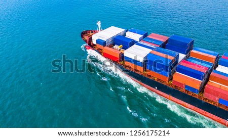 Aerial view cargo container ship carrying container for import and export, business logistic and freight transportation by ship in open sea. #1256175214