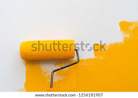 Decorator's hand painting wall by the roller brush for protection and corrosion,Set of tools for painting wall at home #1256181907