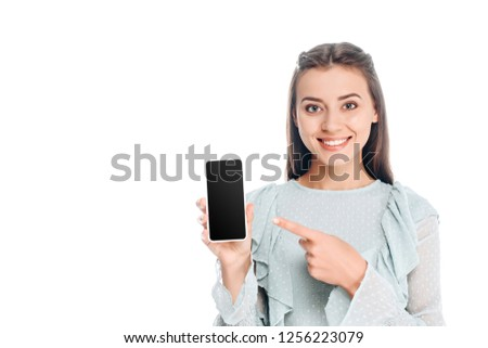 portrait of  smiling woman showing smartphone with blank screen isolated on white #1256223079