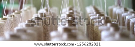 Textile threads industry . Royalty-Free Stock Photo #1256282821