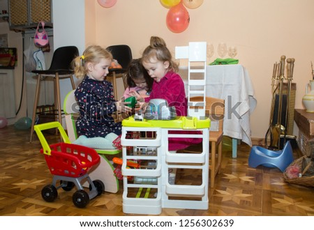 Children play in the seller and the buyer in an imaginary store. #1256302639