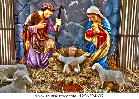 statuettes of Mary, Joseph and baby Jesus,The birthday of Jesus is a statuette of Maria with Joseph and newborn Jesus on the hay