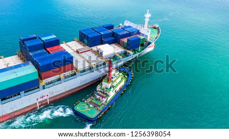 Aerial view container ship carrying container for import and export, business logistic and transportation by ship in open sea. #1256398054