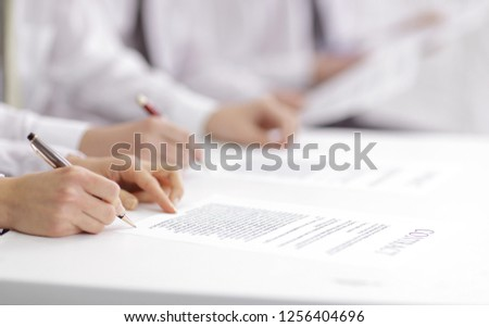 close up. business team studying the terms of the contract #1256404696