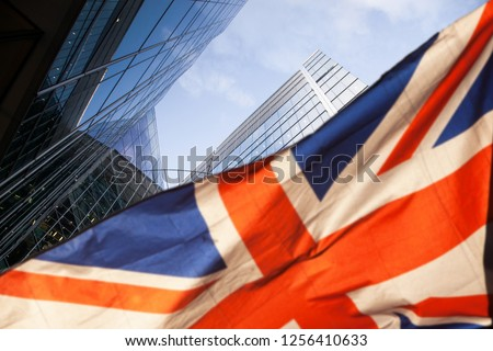 brexit concept - UK economy after Brexit deal - double exposure of flag and Canary Wharf business center skyscrapers #1256410633