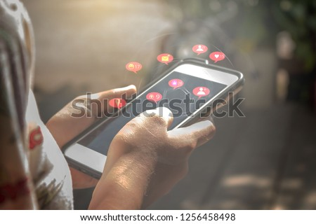 Young women using smart social media concept phones,Social media,social network concept with smart phone - Image #1256458498