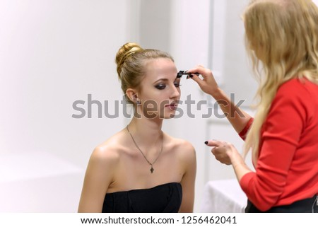 The concept of the work of the master makeup artist beautician. #1256462041