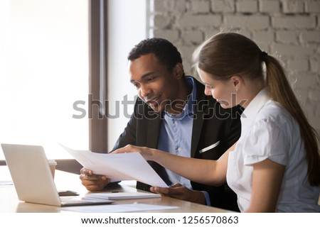 Female financial advisor insurer banker consulting male african american client about contract, caucasian mentor hr and black intern new employee discussing documents at meeting advice #1256570863