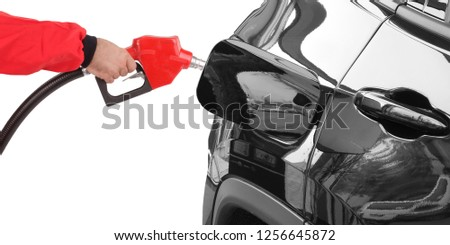 Gasoline pistol pump gun fuel nozzle and car on gas station #1256645872