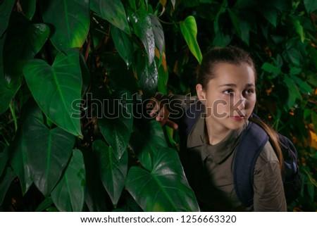 girl traveler walks in the jungle amidst tropical vegetation #1256663320