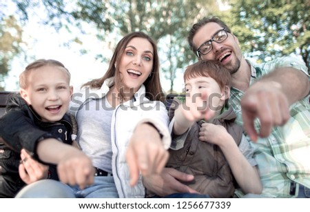 close up.smiling family pointing at you #1256677339