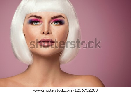 Beauty portrait of attractive woman in colorful glamour makeup and white wig.  #1256732203