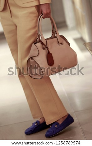 Business women with his bag #1256769574