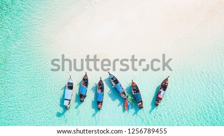 Top view or aerial view of Beautiful crystal clear water and white beach with long tail boats in summer of tropical island or Koh Lipe in Satun,Southern Thailand with copy space #1256789455