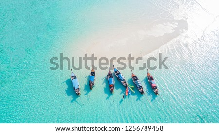 Top view or aerial view of Beautiful crystal clear water and white beach with long tail boats in summer of tropical island or Koh Lipe in Satun,Southern Thailand  #1256789458