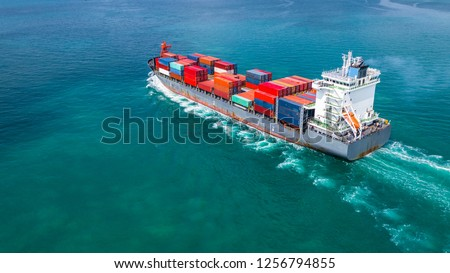 Aerial view container ship carrying container for import and export, business logistic and freight transportation by ship in open sea. #1256794855