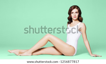 Beautiful, young and fit gilr in white swimsuit #1256877817