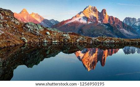 Superb evening view of Chesery lake with Mount Blanc on background, Chamonix location. Amazing autumn sunset in Vallon de Berard Nature Preserve, Alps, France, Europe. #1256950195