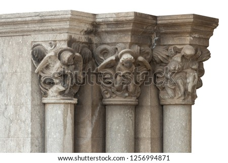 elements of architectural decorations of buildings, columns, pommel and patterns, on the streets in Catalonia, public places. #1256994871