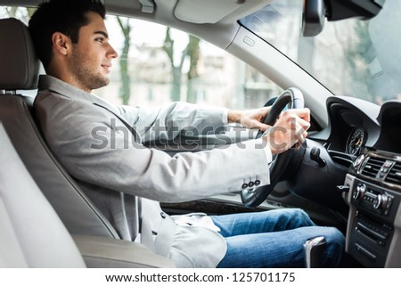 Man driving his car #125701175