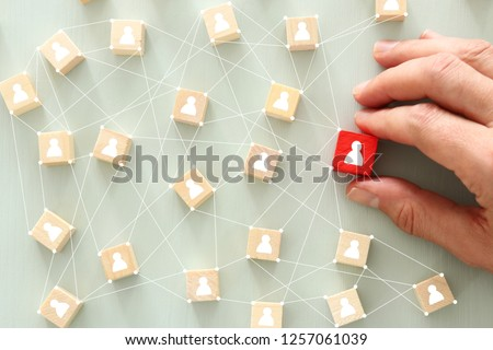 image of wooden blocks with people icon over mint table,building a strong team, human resources and management concept - Image #1257061039