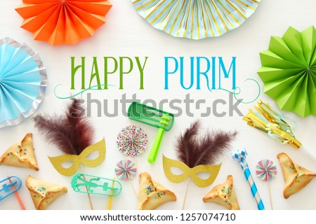 Purim celebration concept (jewish carnival holiday) over white wooden background. Top view - Image #1257074710