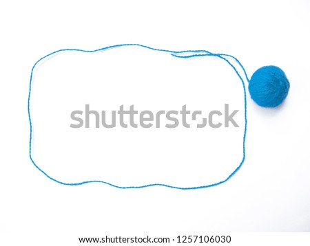 Background of wool yarn, knitted yarn, can also be used as a yarn frame. Blue knitting yarn for handicrafts isolated on white background. #1257106030