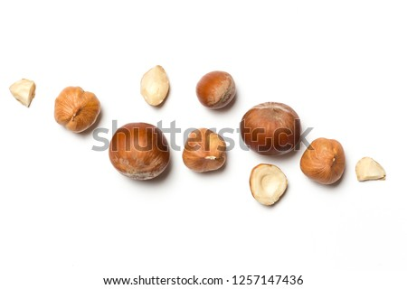 Сomposition of whole and broken hazelnuts and hazelnuts in shell on a white background #1257147436